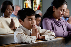 Hands Folded during Prayer at Mass